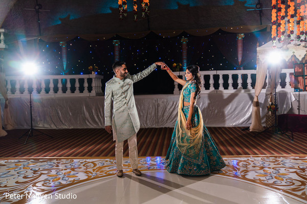 Indian couple at their sangeet dance capture.