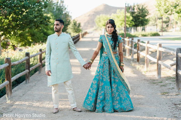 Indian couple pre-wedding lehenga and sherwani.