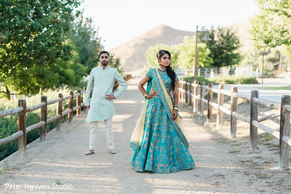 Maharani and Rajah on their Sangeet light blue outfits.