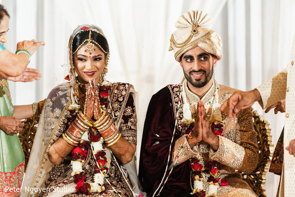 Indian couple praying during their wedding ceremony.
