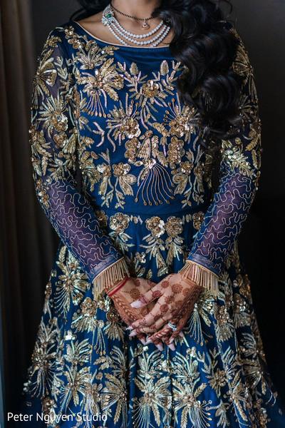 Royal blue Anarkali embellished with gold embroidery.