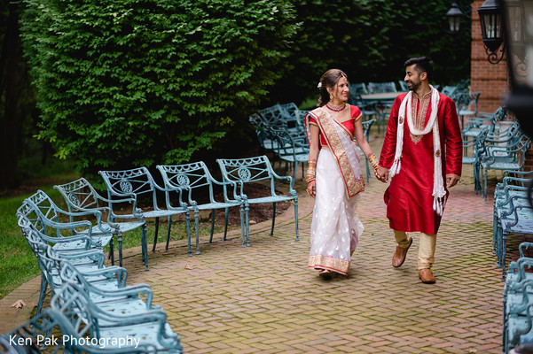Indian couple gazing into each other ehes while walking hand in hand