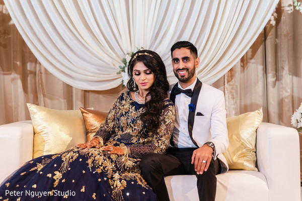 Indian couple's portrait at their wedding reception stage.
