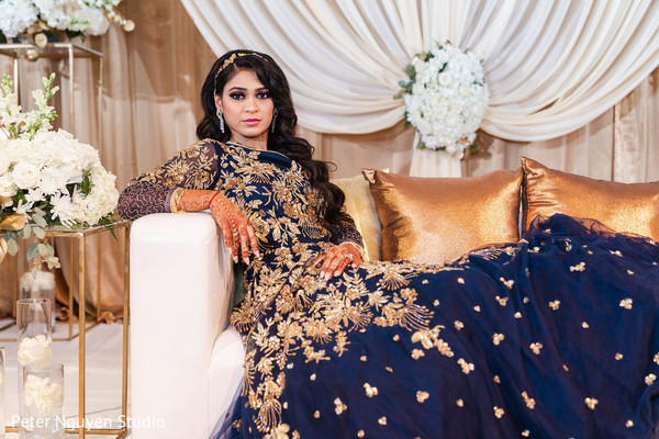 Indian bride posing at her reception stage.
