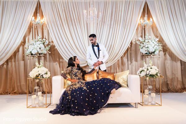Elegant Indian couple's wedding reception portrait.