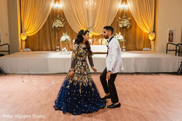 Indian couple dancing at their wedding reception.