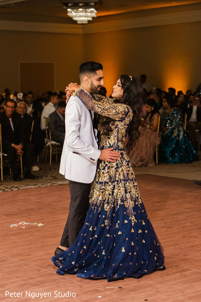 Indian bride and groom dancing together for their first time.
