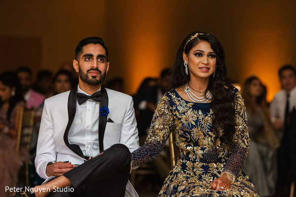 Elegant Indian couple during their reception entertainment.