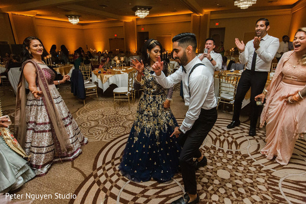 Indian couple dancing together as husband and wife.