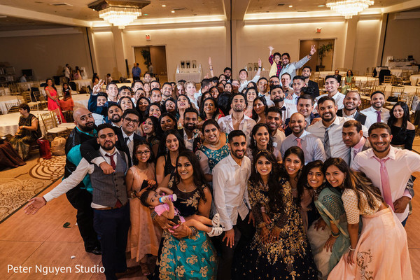 Group Indian wedding guests portrait.