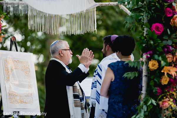 A rabbi performing the Jewish ceremony