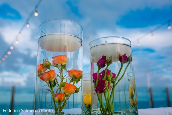 Centerpieces with floating flowers and candles.