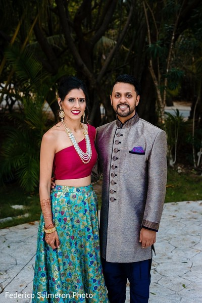 Indian couple's beach sangeet outfits.