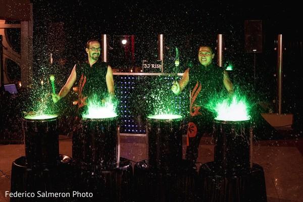 Liquid neon drummers entertaining at sangeet night.