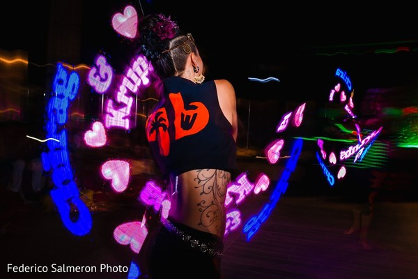 Neon dancers performing at sangeet party.