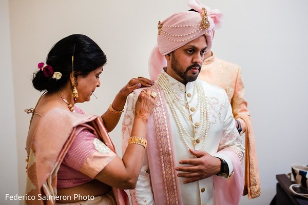 Indian groom preparing his ceremony outfit.