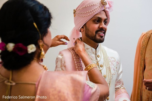 Indian groom pink turban.