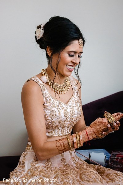 Indian bride placing her bridal bangles.