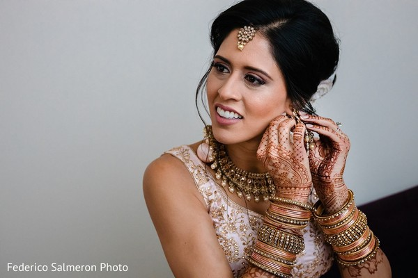 Indian bride getting her jewelry ready for her ceremony.