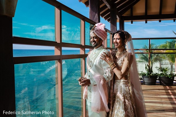Indian couple posing next to window photo shoot.