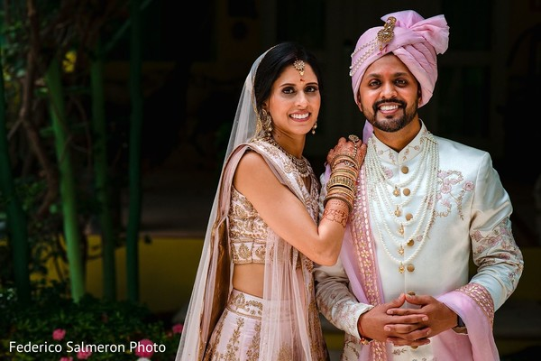 Indian couple posing on their ceremony outfits portrait.