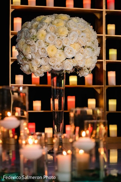 Tall Indian wedding white flowers and roses decoration.
