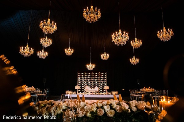 Dreamy Indian wedding reception chandeliers decoration.