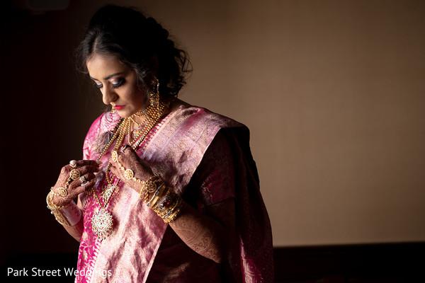 Maharani in fuchsia and pink getting ready