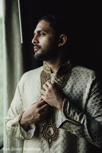 Indian groom getting ready
