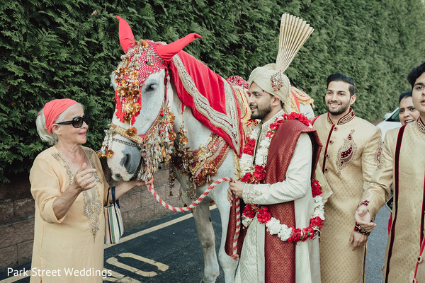 Indian groom and relatives with the Baraat mare