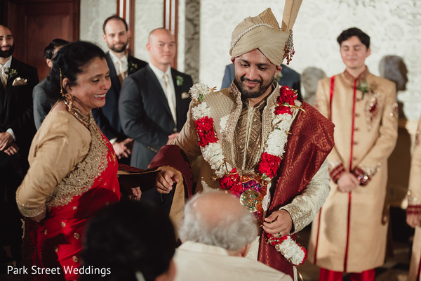Indian groom greeting Indian relatives at the mosque