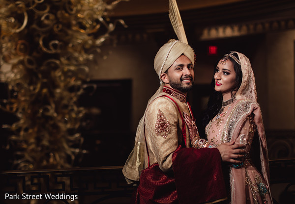 Indian newlyweds holding each other close