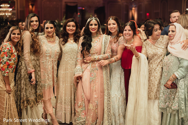 Maharani and her female Indian relatives posing at the reception hall