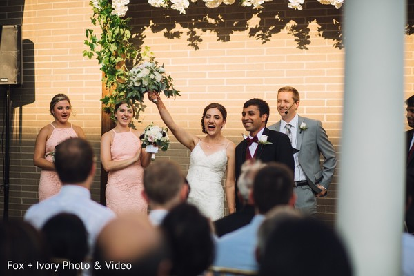 Indian bride celebrating after the ceremony.