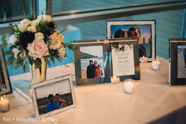 Table of pictures from the Indian newlyweds at the reception venue.