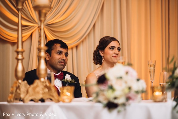 Indian bride and groom during speeches.