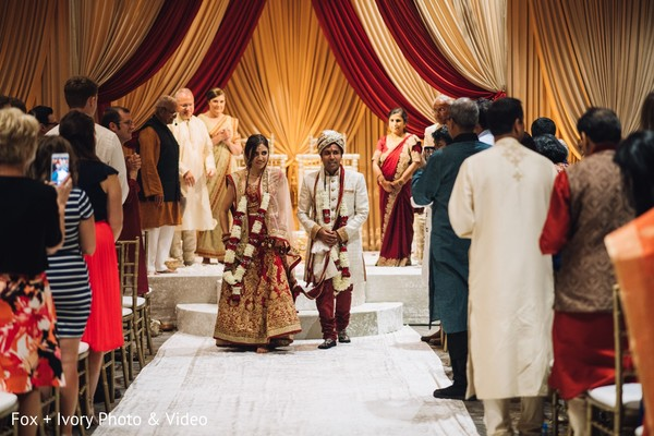 Indian groom and bride leaving the ceremony.