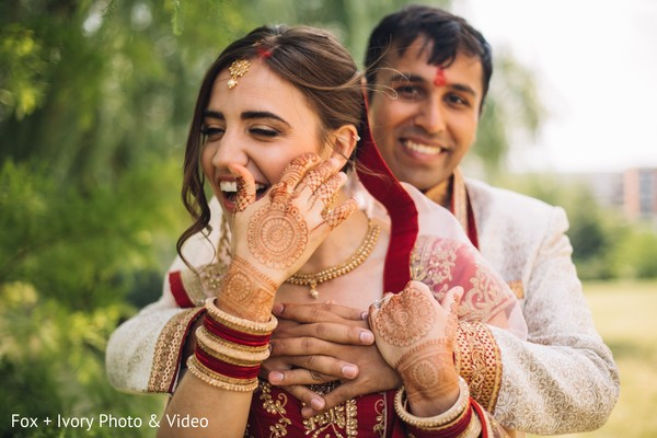 Indian bride and groom having a great time during pictures.