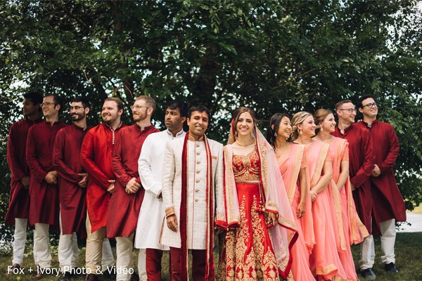 Maharanis and groomsmen posing with the Indian newlyweds.
