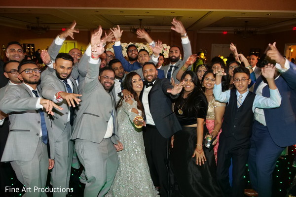 Indian newlyweds with special guests during the reception.