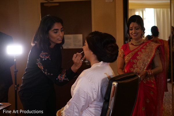 Maharani being assisted by makeup artist prior to the ceremony.