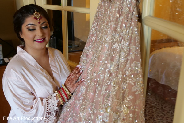 Indian bride with her ceremonial lengha prior to the ceremony.