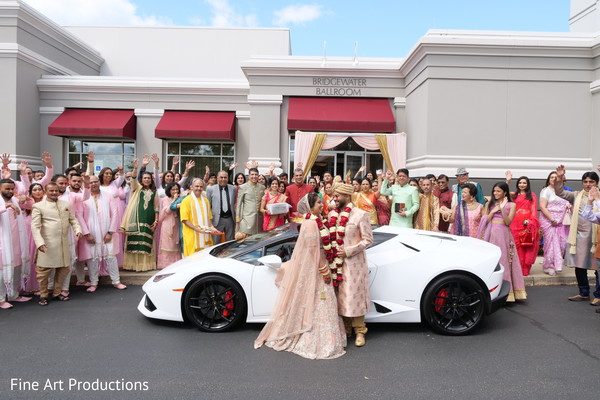 Indian bride and groom by their rides.