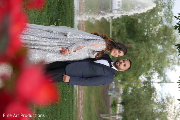 Indian bride and groom posing during the outdoor photoshoot session.