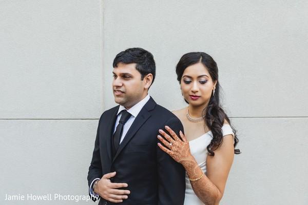 Maharani touching her Indian groom's shoulder.