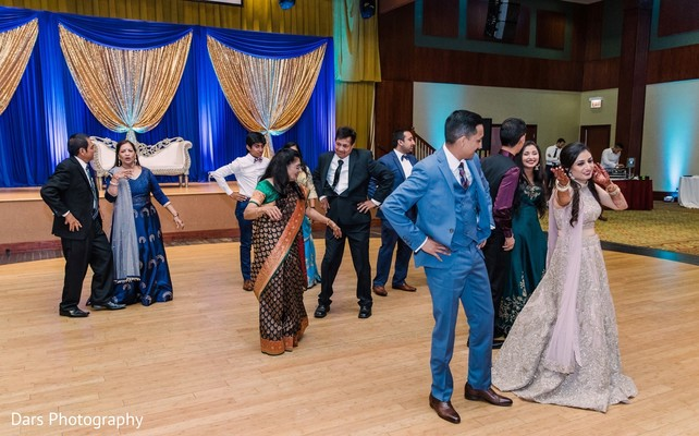 Indian bride and groom leading a reception choreography.