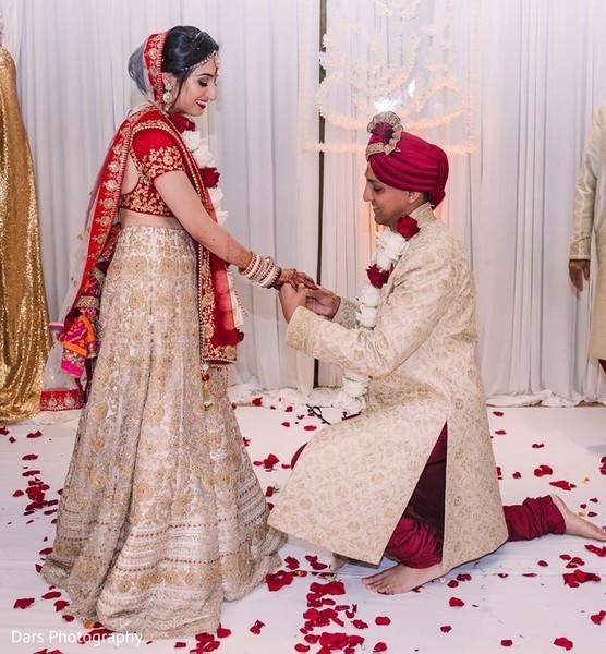 Indian bride and groom exchanging wedding rings.