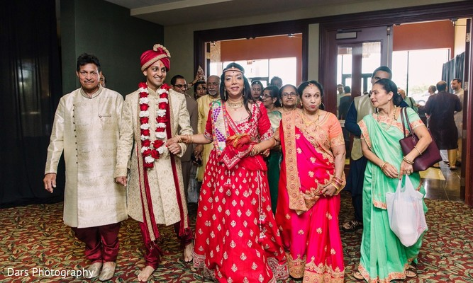 Indian groom being welcome by his in-laws.