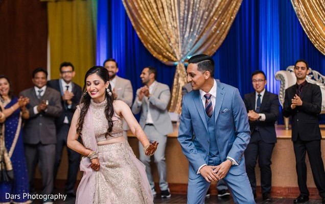 Indian couple showing off their dance moves.