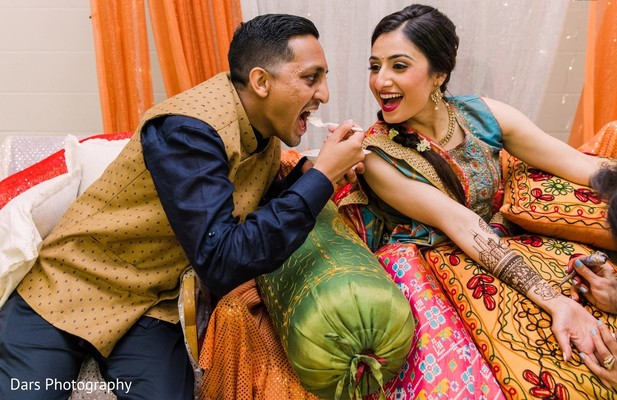 Indian bride and groom at mehndi party.
